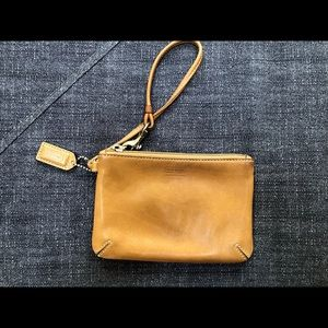 Brown leather Coach wristlet